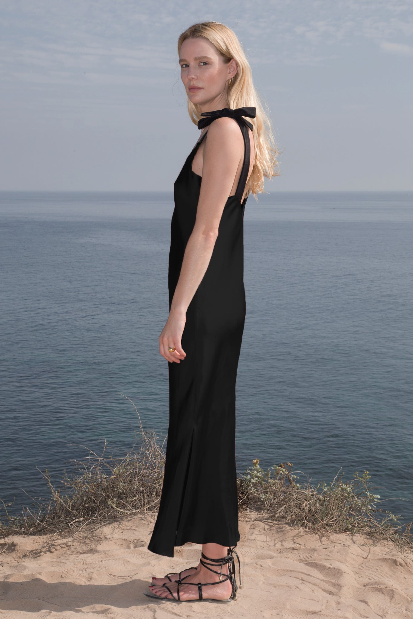 Model wears MARION SLIP DRESS - Black by Heidi Merrick (Side)