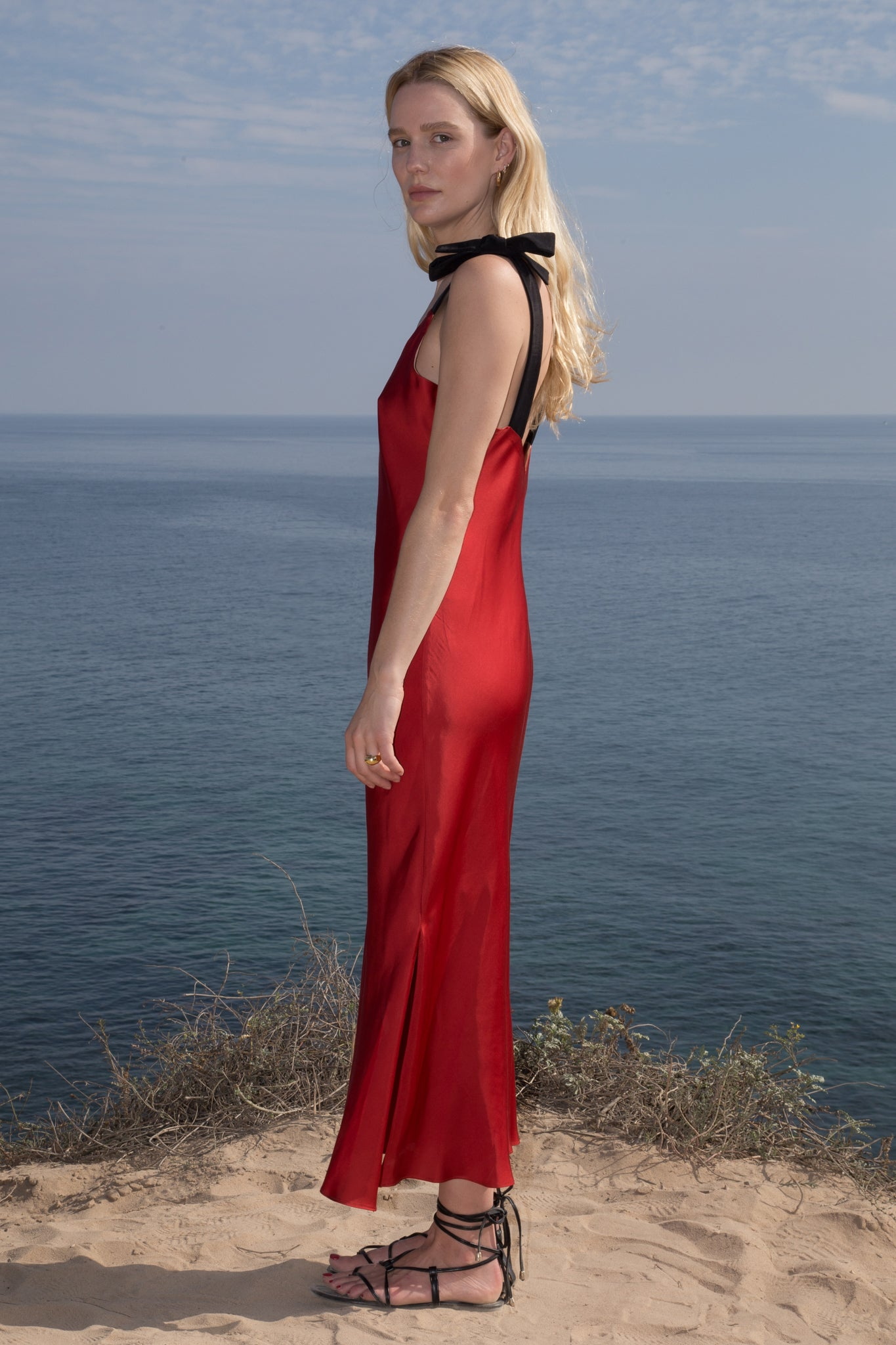 Model wears MARION SLIP DRESS - RED by Heidi Merrick (Side)