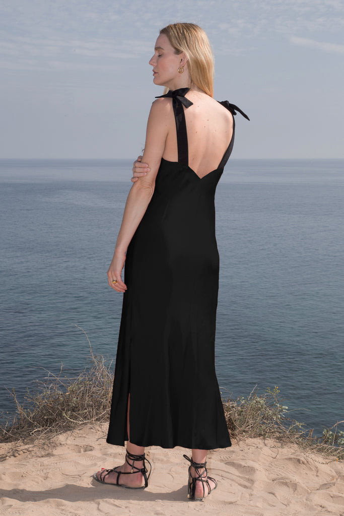Model wears MARION SLIP DRESS - Black by Heidi Merrick (Back)