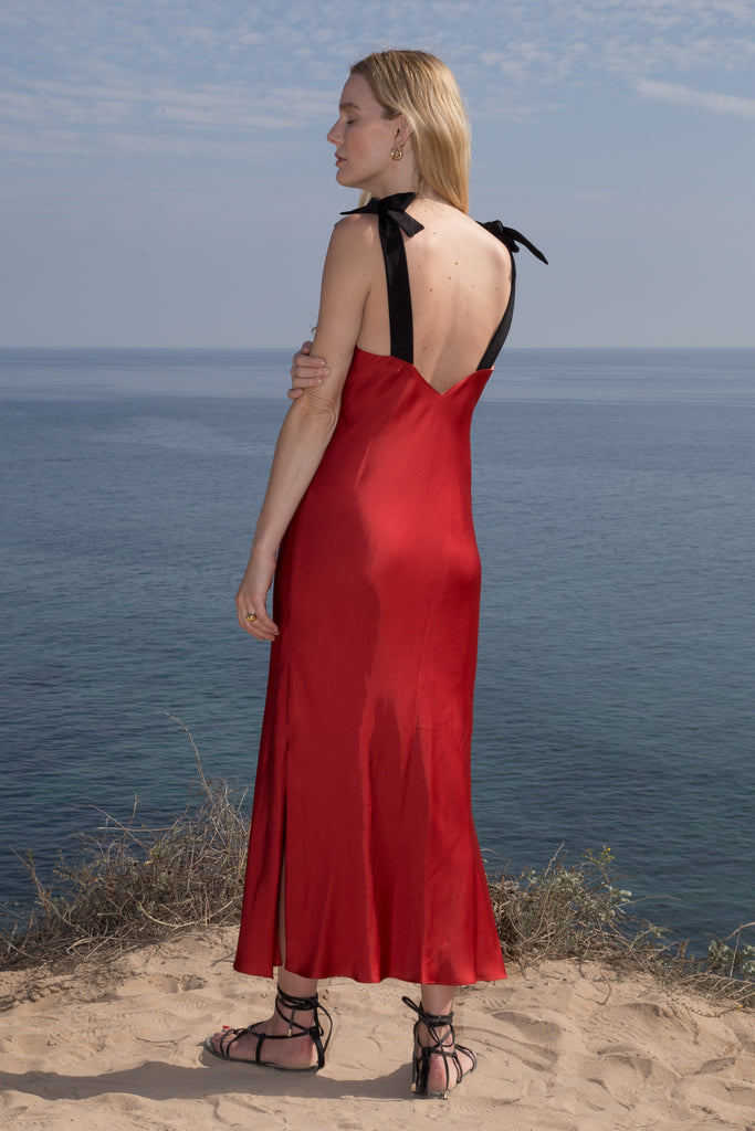 Model wears MARION SLIP DRESS - RED by Heidi Merrick (Back)
