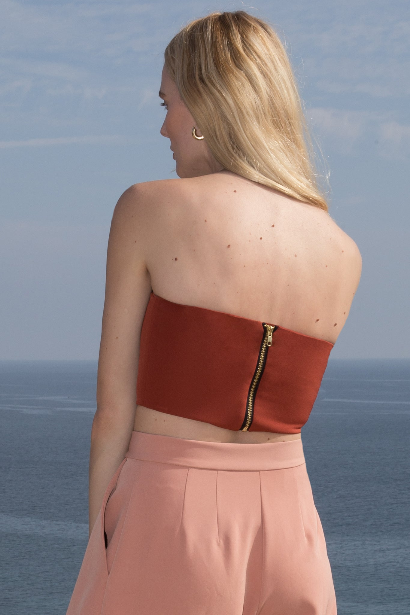 Model wears BANDEAU TOP - RUST by Heidi Merrick (Back)