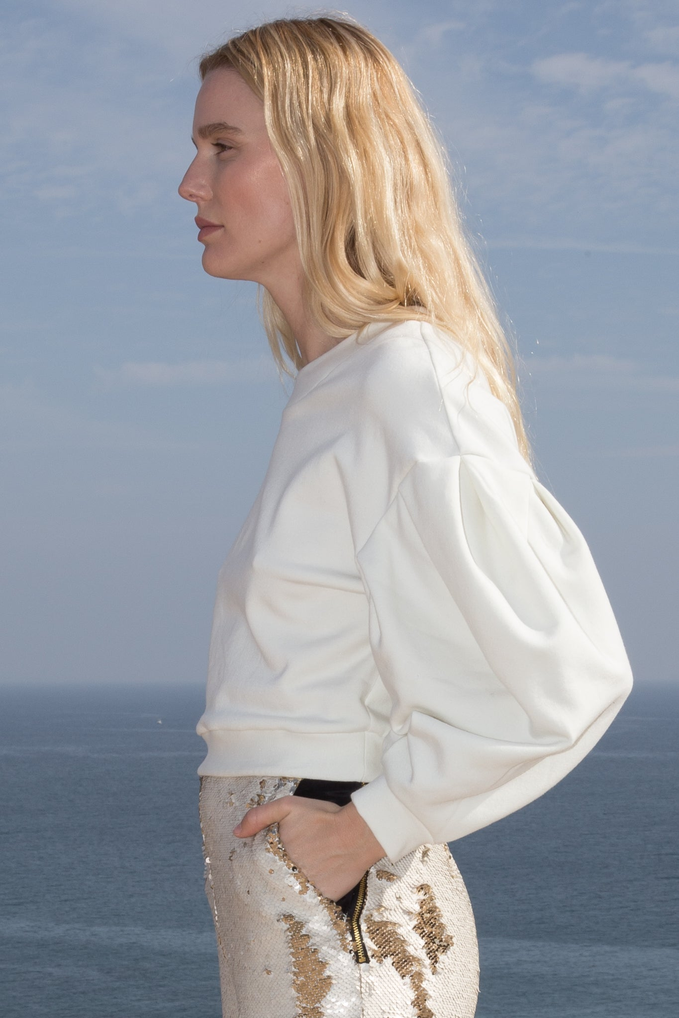 Model wears VERLAINE SWEATER - IVORY by Heidi Merrick (Side)
