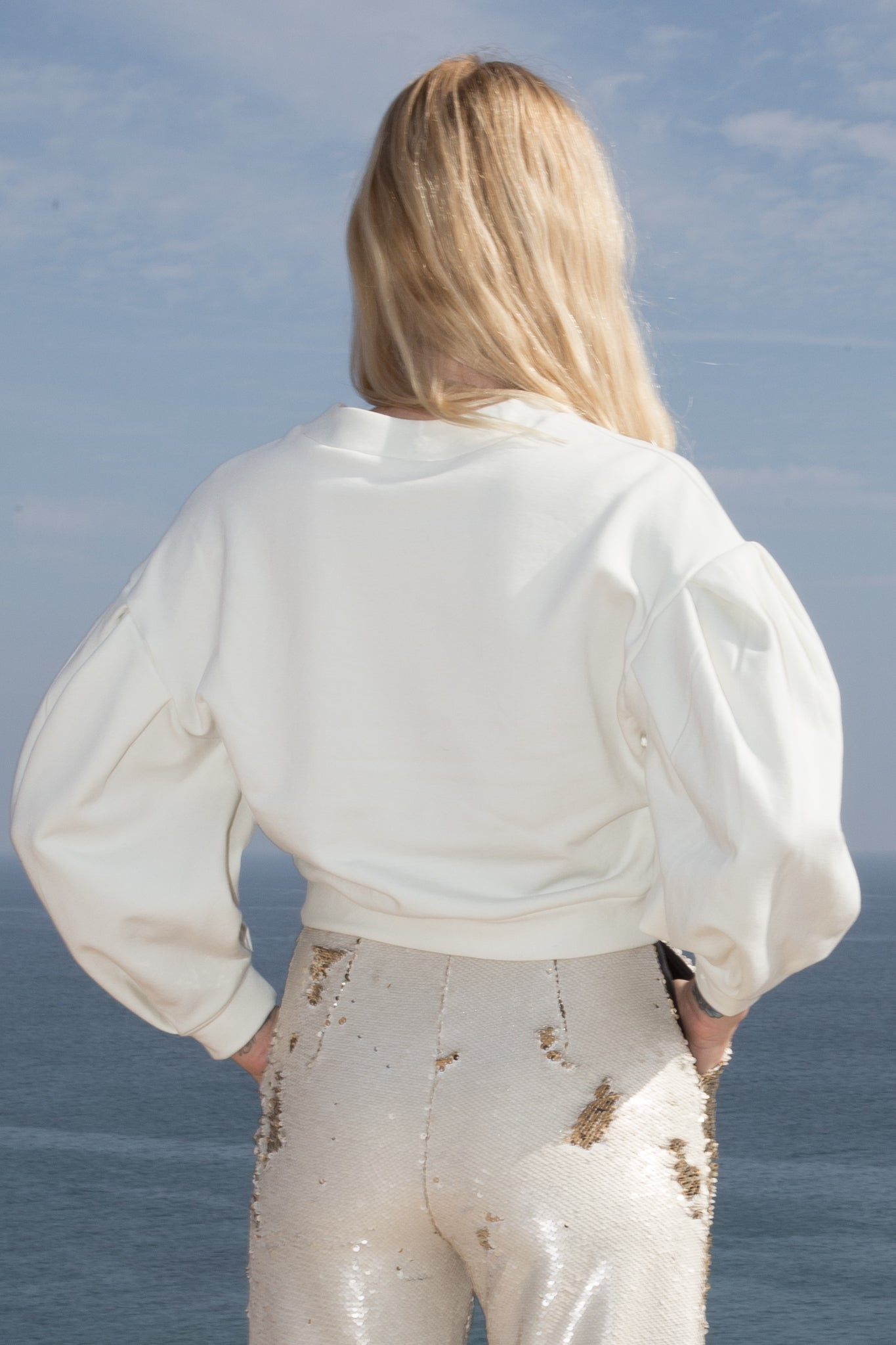 Model wears VERLAINE SWEATER - IVORY by Heidi Merrick (Back)