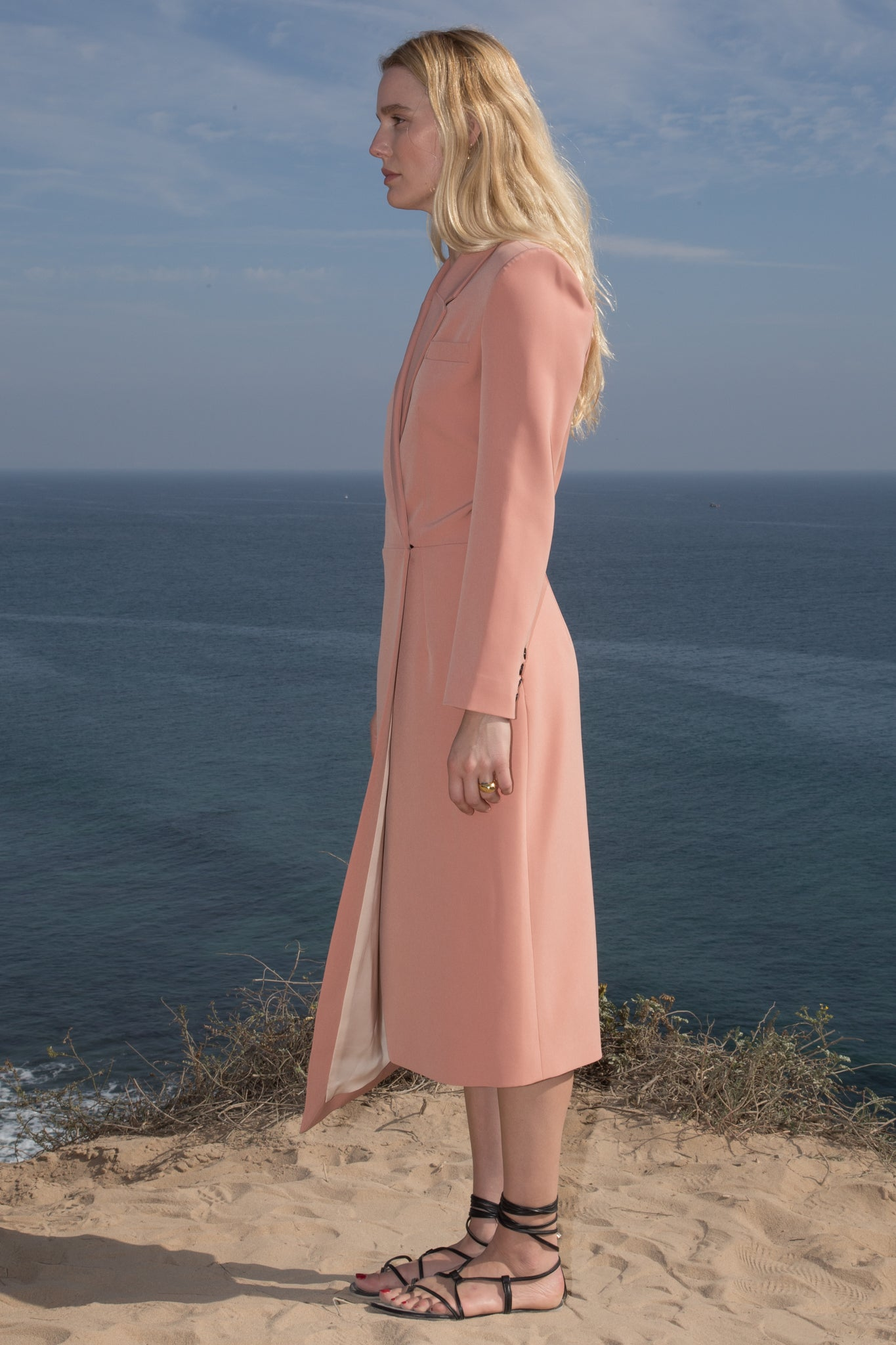 Model wears BLAZER DRESS - PETAL by Heidi Merrick (Side)