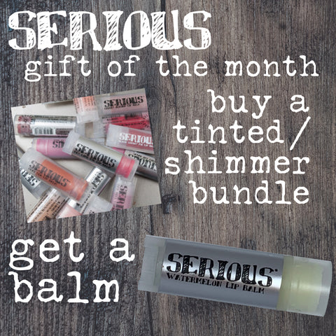 Tinted and Shimmer lip balms with white text that says they are the gifts of the month for April 2021