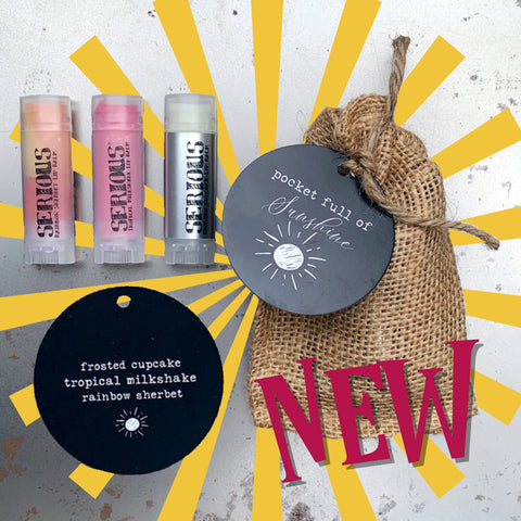 Pocket Full of Sunshine Lip Balm Bundle in a burlap bag with a black tag, shown with three lip balms on a silver background with a sunshine graphic