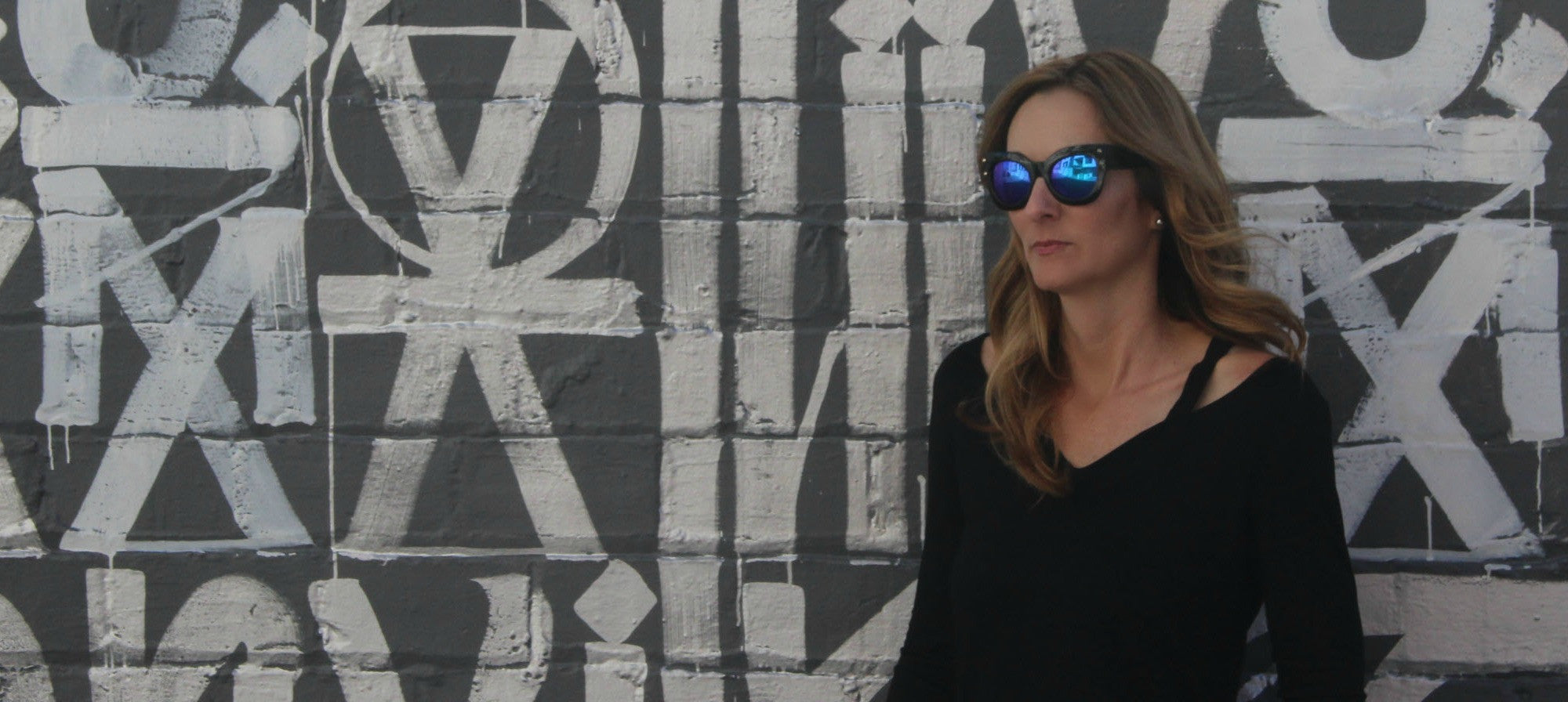 Edgy, thick-rimmed women's fashion sunglasses with stud detail and mirrored lenses inspired by Los Angeles, the City of Angels | socalsunnies.com