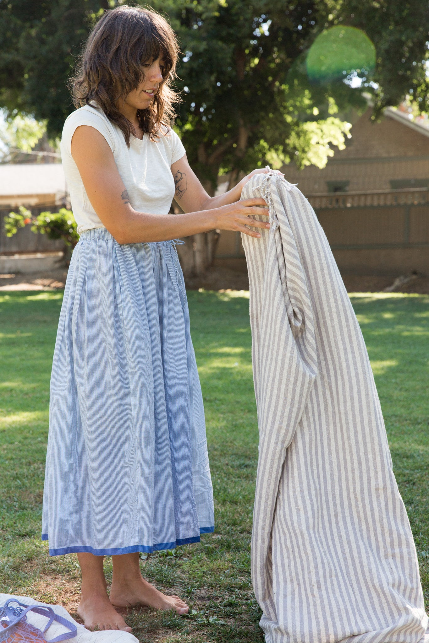 picnic blanket in injiri skirt and it is well tee