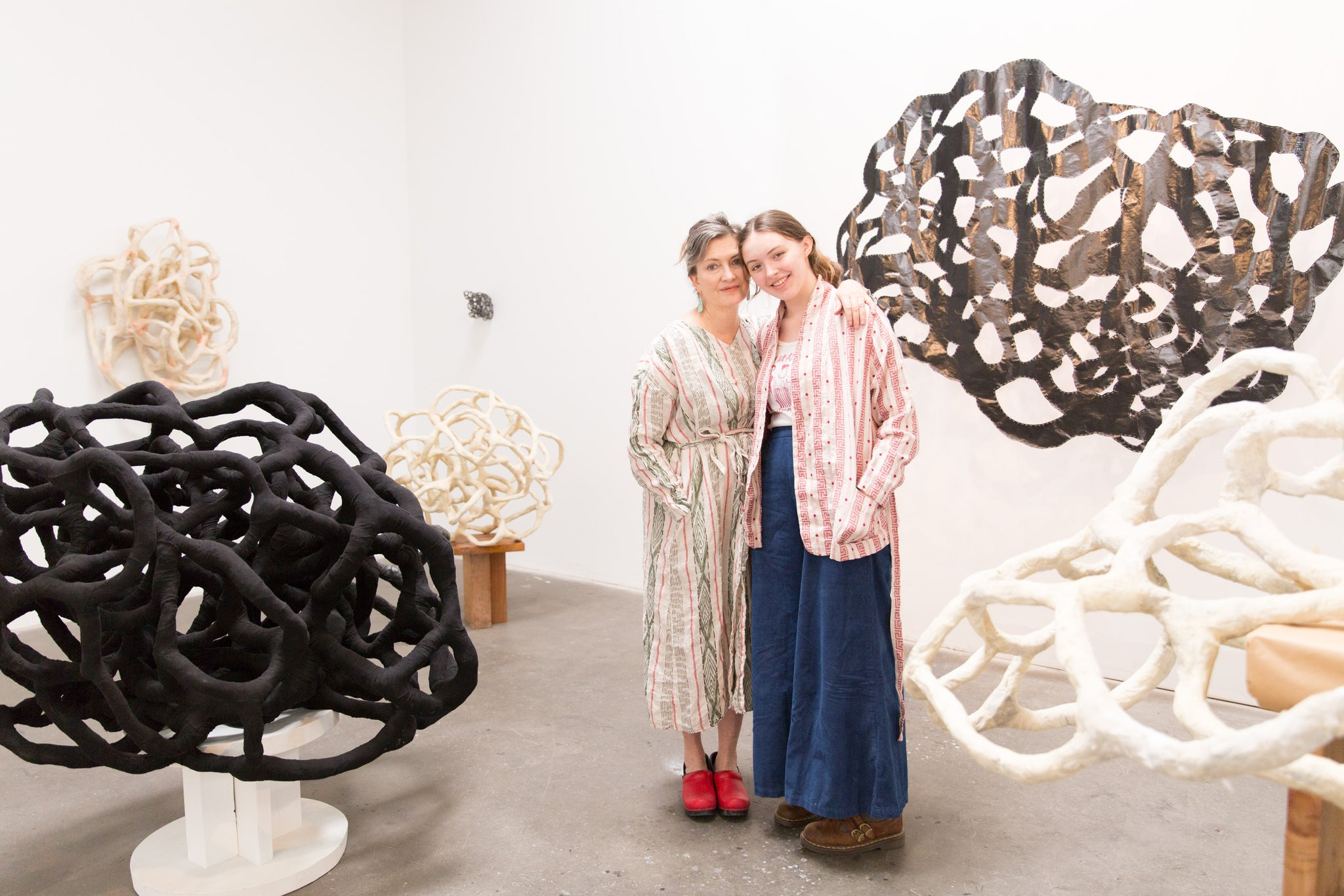 artist Laura Cooper and her daughter surrounded by sculpture in Los Angeles studio