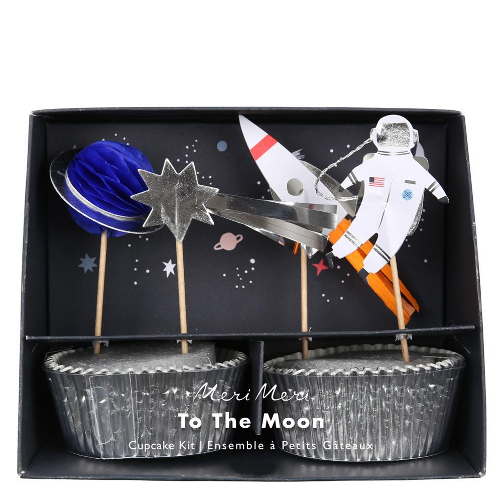 Front view of space themed cupcake decorating kit featuring an astronaut and planet toppers