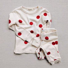 Load image into Gallery viewer, Flat lay view of red polka dot pajamas