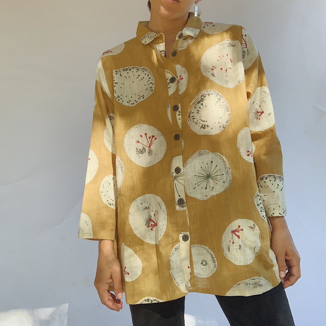 Close up front view of the Mona Lisa Dandelion Print Button Down top in mustard.
