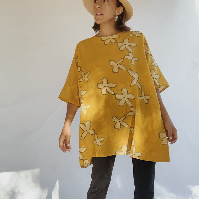 Front view of the Mona Lisa Paper Flower tunic in mustard.