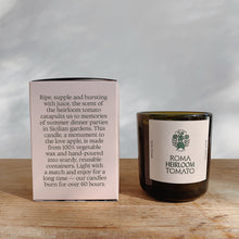 Load image into Gallery viewer, Roma heirloom tomato candle next to its pink packaging.