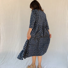 Load image into Gallery viewer, baci tile dress back side view on model with linen background