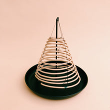 citronella coil incense on holder