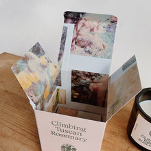 Load image into Gallery viewer, Close up view of Tuscan rosemary candle light pink box featuring photographs printed inside the box.