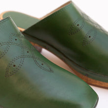 detail of square toe clog in green