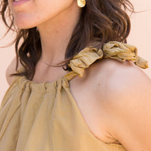 close up view golden bow dress from sausalito