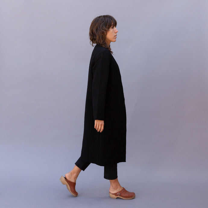 side view of black arya coat by chalet