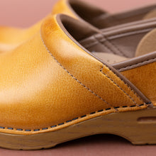 close up view dansko honey professional clog
