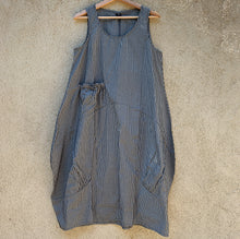 Load image into Gallery viewer, Front view of the Tulip grey striped dress hanging on a hanger.