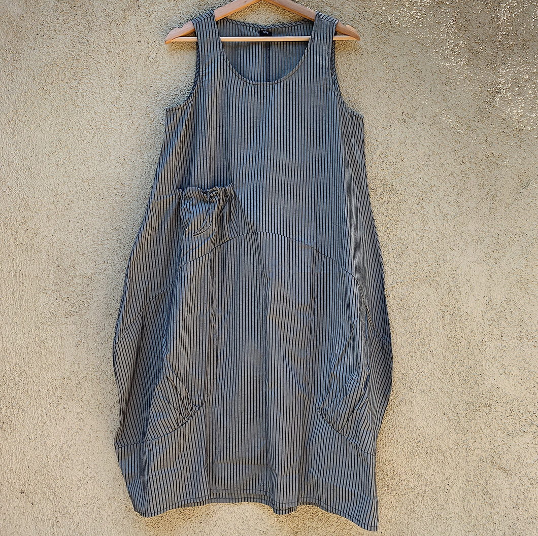 Front view of the Tulip grey striped dress hanging on a hanger.