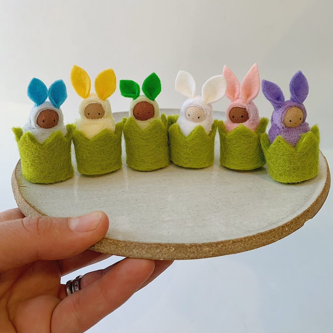 felt baby bunnies lined up on little tray front view