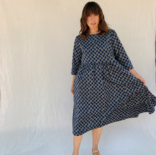 Load image into Gallery viewer, baci tile dress movement front view on model with linen background