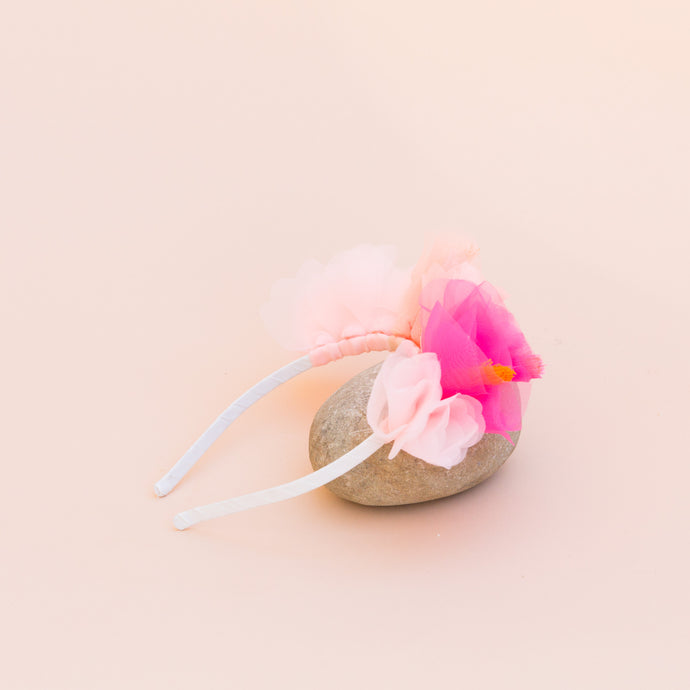 flower headband propped against rock