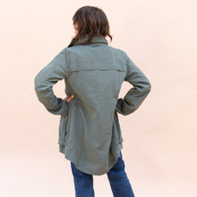 back view of green parka