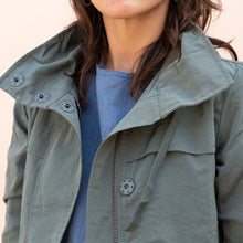 close up collar view of green parka