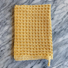 Load image into Gallery viewer, waffle knit daisy towel laydown folded on marble
