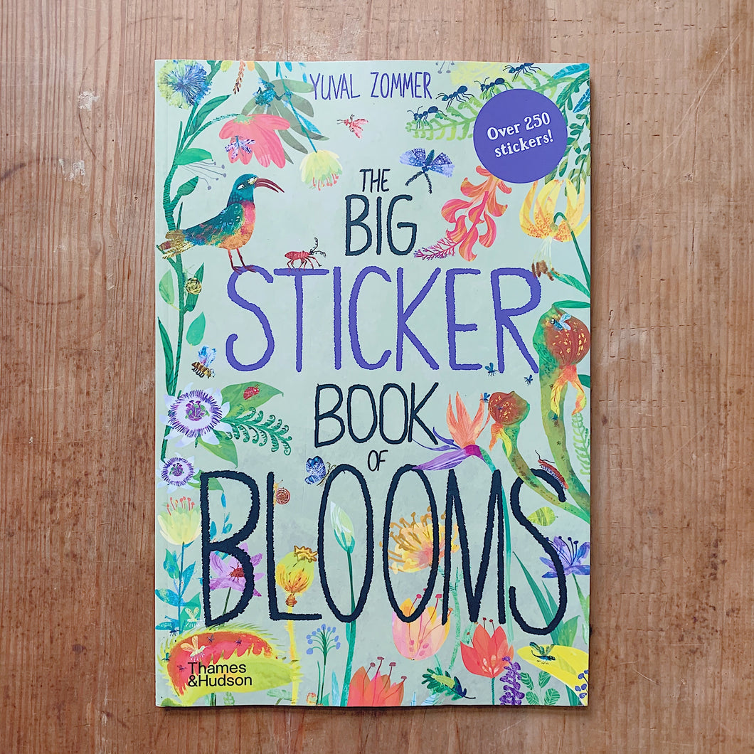big sticker book of blooms cover shot laydown top view on wooden background