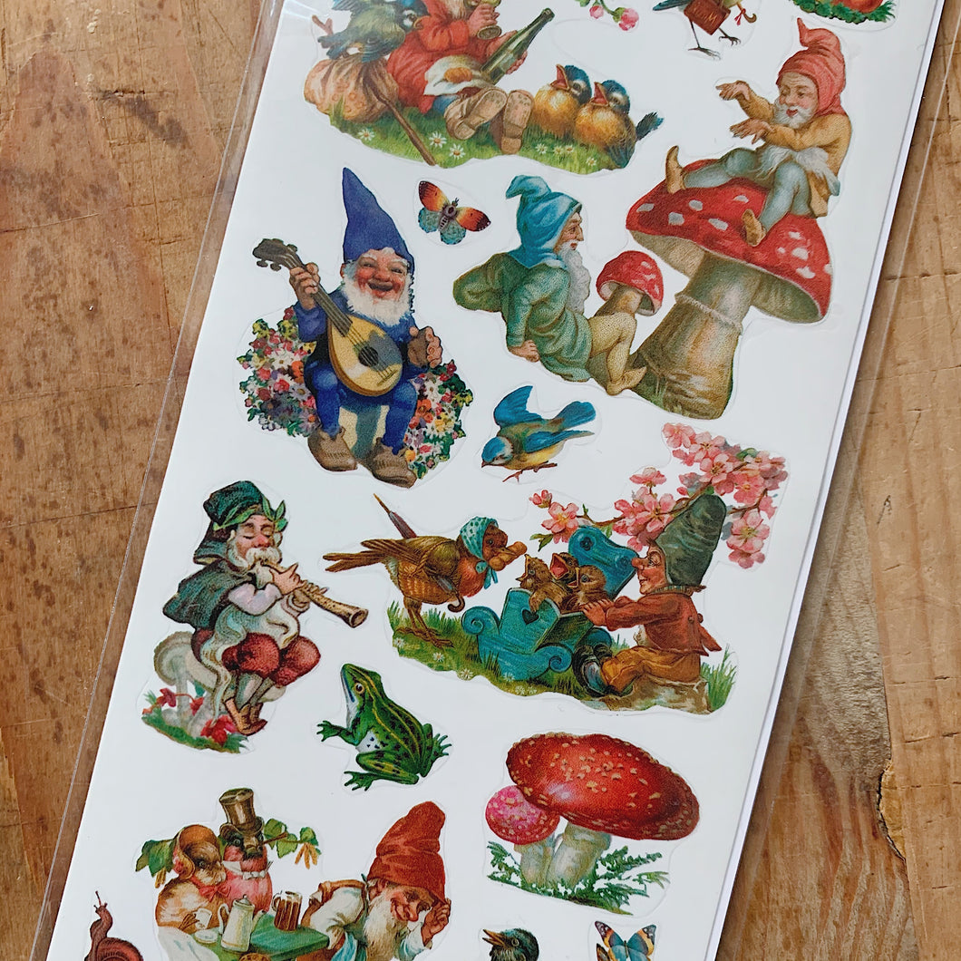 Overhead close up shot of garden gnomes and forest mushroom stickers