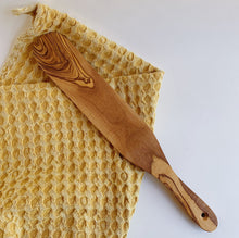 Load image into Gallery viewer, waffle knit daisy towel laydown folded with wooden spurtle