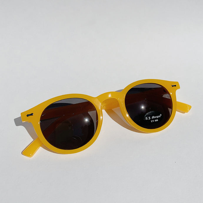 tangerine sunglasses laydown top view on white background