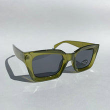 Load image into Gallery viewer, green rectangle glasses front view tilted laydown on white background