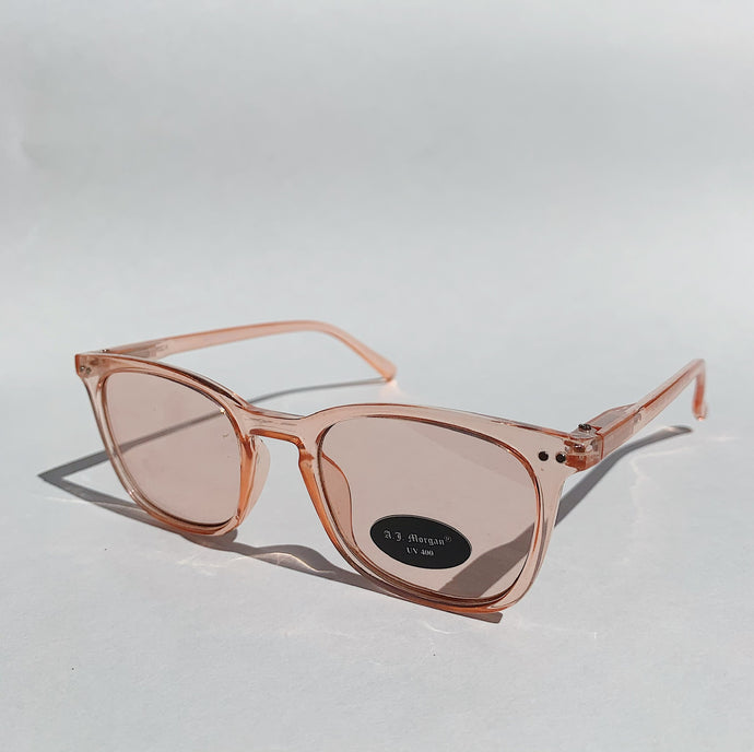rose tinted sunglasses laid down front view tilted on white background