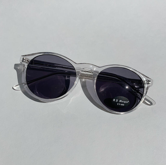 clear sunglasses laydown top view on white background
