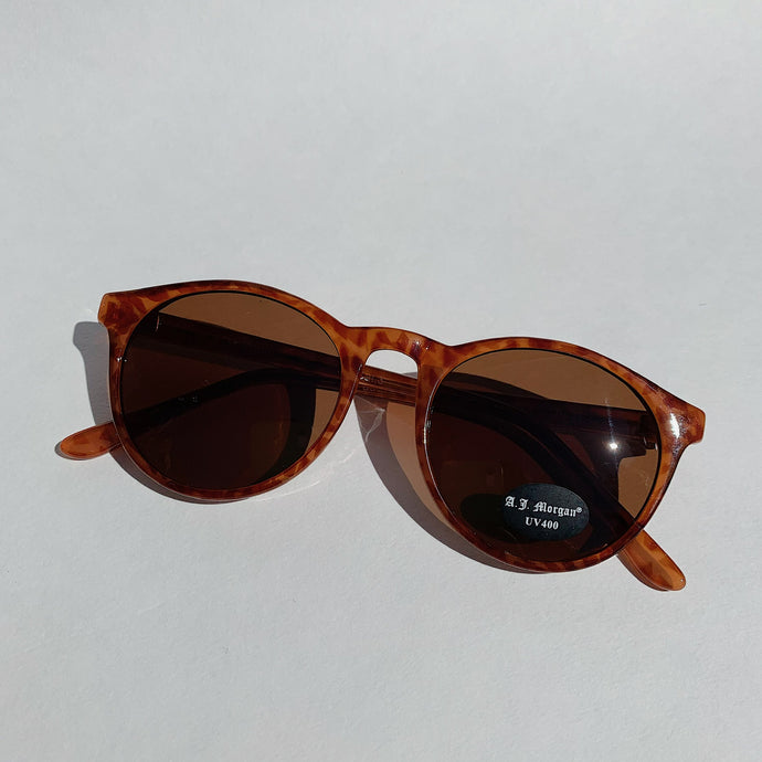 tortoiseshell sunglasses laydown top view on white background