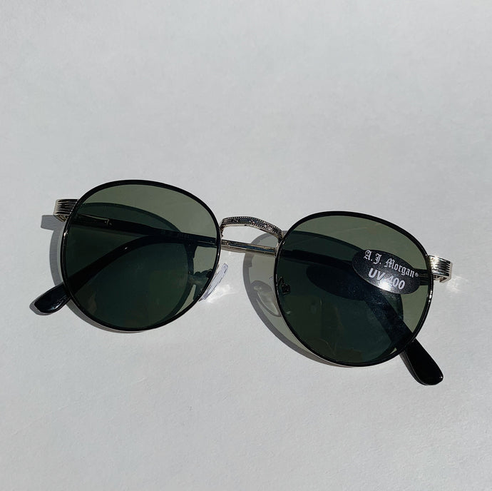 wire rimmed sunglasses lay down top view on white background