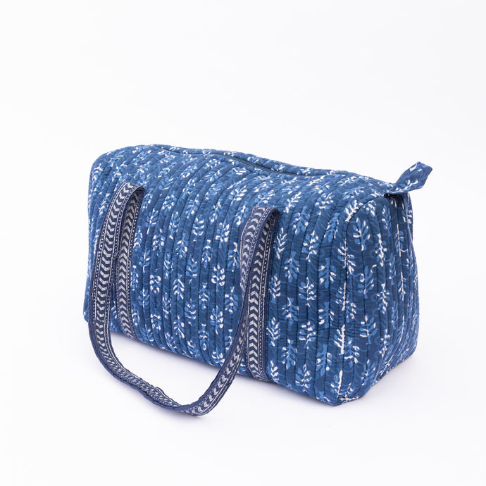 diagonal view of indigo duffle