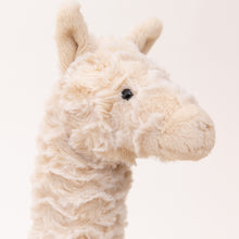 close up view of lars llama by jellycat