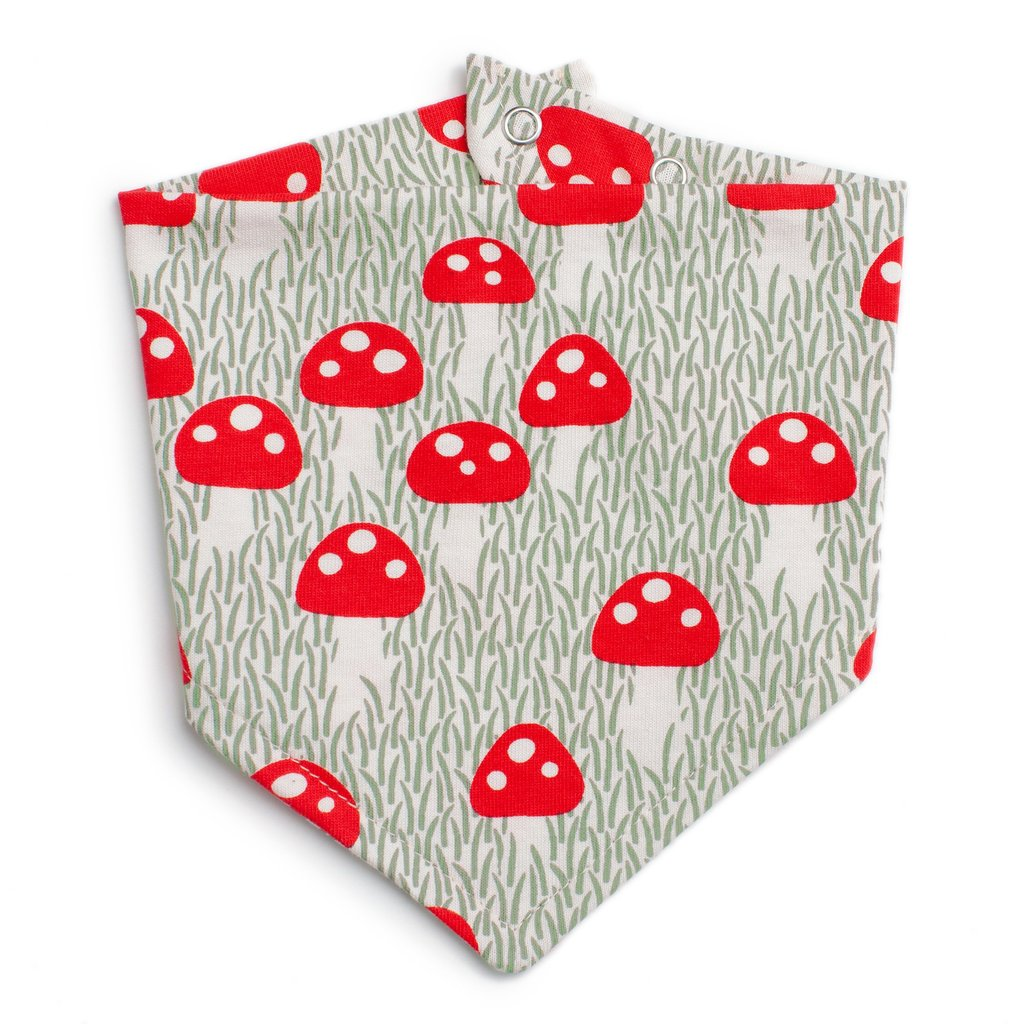 Flat lay view of kerchief bib in an all over mushroom  print