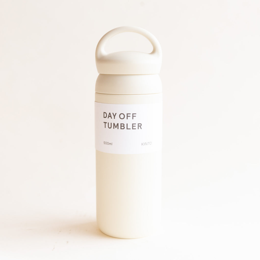 front view of day off tumbler in white