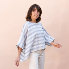 diagonal view of pocket blouse in blue and white