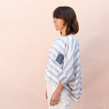 side view of pocket blouse in blue and white