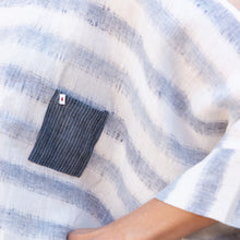 detail of pocket blouse in blue and white