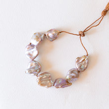 Load image into Gallery viewer, overhead view of pearl bracelet